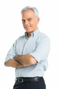 Happy Mature Man With Hands Folded after Hair Loss Treatment