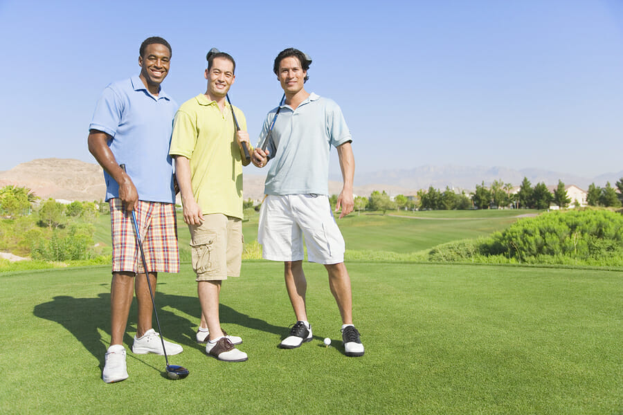 Portrait of three men on golf course demonstrating results of hair regrowth treament